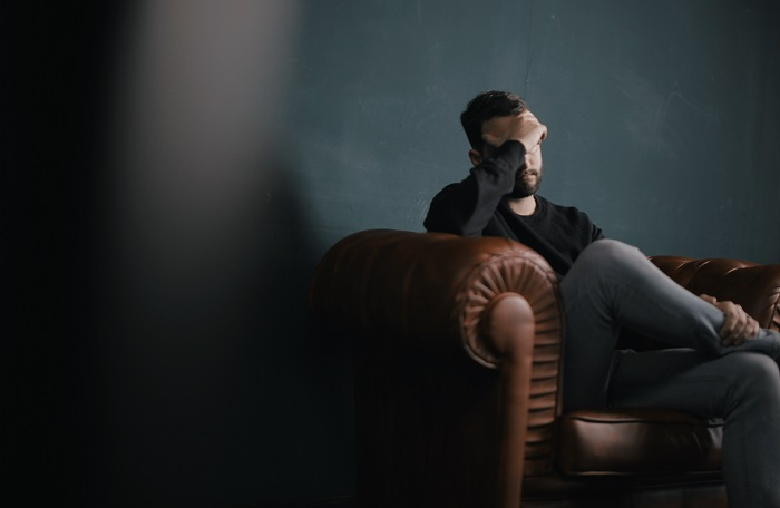stressed guy on sofa